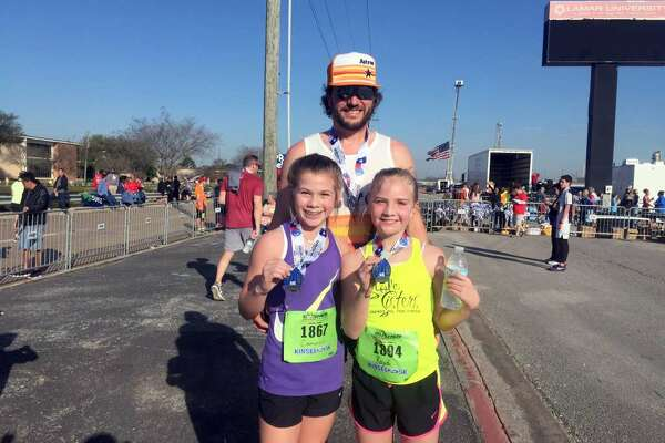 Gusher 5K run participants Chad Hawthorne, top, with his daughter, Kaydi, and her friend Cameron Jenkins.  March 3, 2018