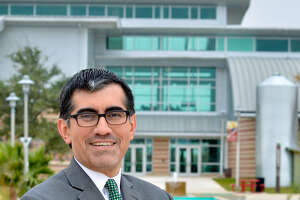 Alamo Colleges named Mike Flores as the new chancellor of the district on Saturday, March 3, 2018.