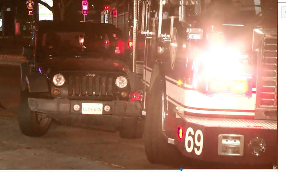 An HFD fire truck and Jeep driver collided at 3:30 a.m. at South Gessner and Westheimer, authorities said. Photo: Metro Video