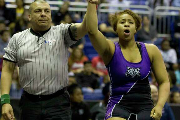 Eloni Sowell of Humble reacts after winning the Class 5A girls 185-pound title during the UIL State Wrestling Championships at the Berry Center, Saturday, Feb. 24, 2018, in Cypress.