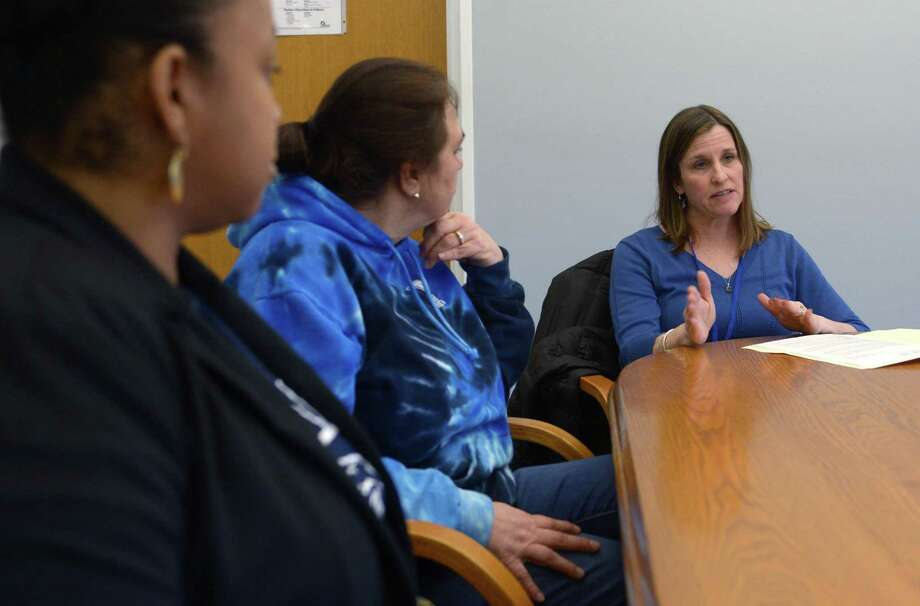 Gail Melanson, clinical director of the Child Guidance Center of Mid-Fairfield County, right, talks with Norwalk elementary school principals including Zakiyyah Baker from Kendall and Sue O'Shea from Marvin during a meeting at Naramake Elementary School Friday in Norwalk. Melanson will be providing intervention and support to adults and students at Norwalk Public Schools. Photo: Erik Trautmann / Hearst Connecticut Media / Norwalk Hour