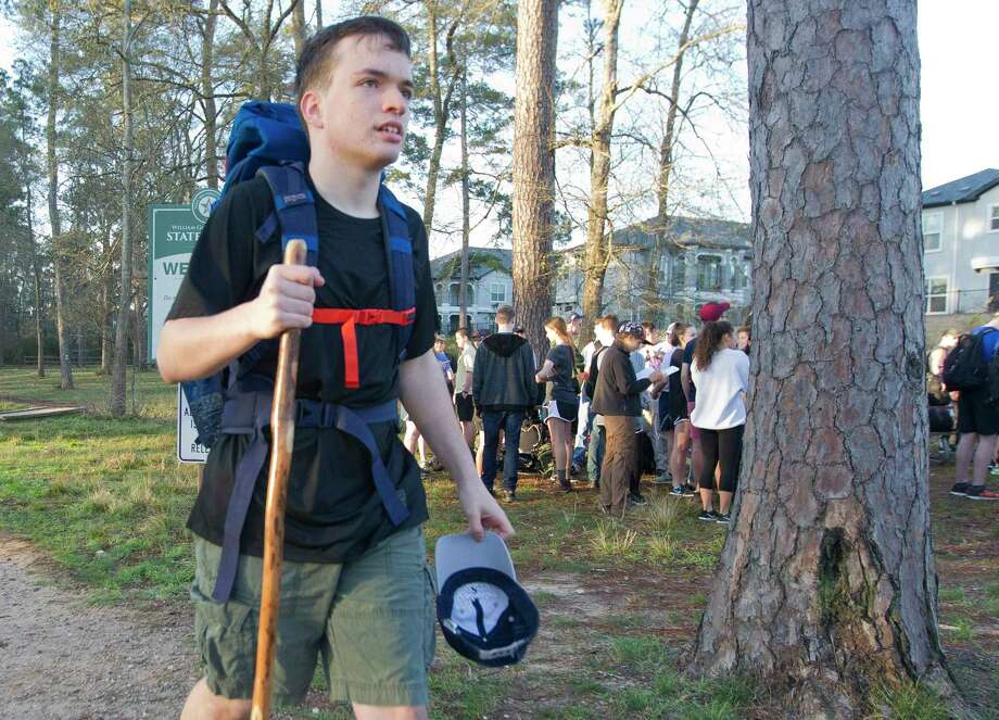 Noah Martin heads to a gathering of fellow Air Force JROTC cadets as 150 JROTC members from Oak Ridge and The Woodlands High School gather at W.G. Jones State Forest on Saturday to march 14 miles in remembrance of the Bataan Death March. Photo: Jason Fochtman, Staff Photographer / © 2018 Houston Chronicle