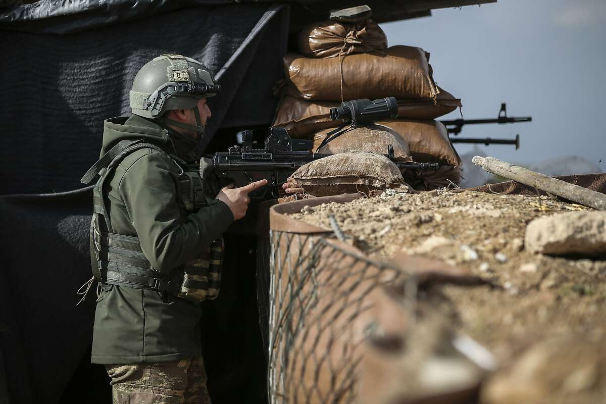 A Turkish soldier holds a position atop the Bursayah hill in the greater Afrin district, Syria, during a Turkish government-organised media tour into northern Syria, Saturday, March 3, 2018. Already in the sixth week of its offensive on the Kurdish-held enclave of Afrin in northwestern Syria, Turkey wants to oust the Syrian Kurdish People's Protection Units, or YPG, from Afrin. It considers the group an extension of a Kurdish insurgency within its own borders. (AP Photo/Emrah Gurel)