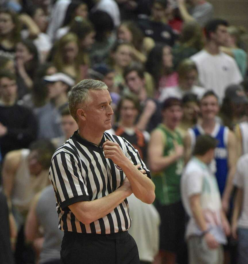 Bob Pique works the boys basketball game between Fairfield Warde and Ridgefield high schools, on Wednesday night. Pique has been refereeing since high school, the last 13 years in this area. February 21, 2018, at Ridgefield High School, in Ridgefield, Conn. Photo: H John Voorhees III / Hearst Connecticut Media / The News-Times