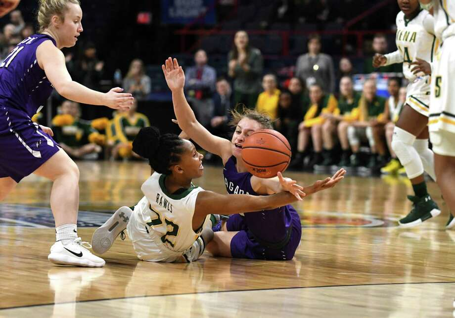 Siena guard Deja Rawls, left, fights for a  loose ball with Jamie Sherburne of Niagara University during MAAC championship basketball quarterfinals on Saturday, March 3, 2018, at the Times Union Center in Albany, N.Y. (Will Waldron/Times Union) Photo: Will Waldron / 20043033A