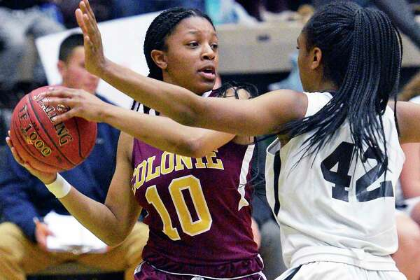 Colonie's #10 Lashia Ricketts battles Bethlehem's #42 Langston Williams during their Class AA girls' final game against Saturday March 3, 2018 in Troy, NY. (John Carl D'Annibale/Times Union)
