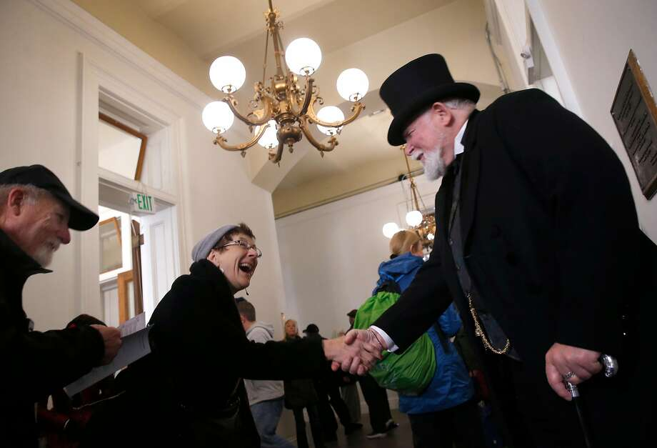 Michael Smith, dressed as railroad tycoon Leland Stanford, greets visitors to the San Francisco History Days event at the Old Mint, which features costumed characters and displays. Photo: Paul Chinn, The Chronicle