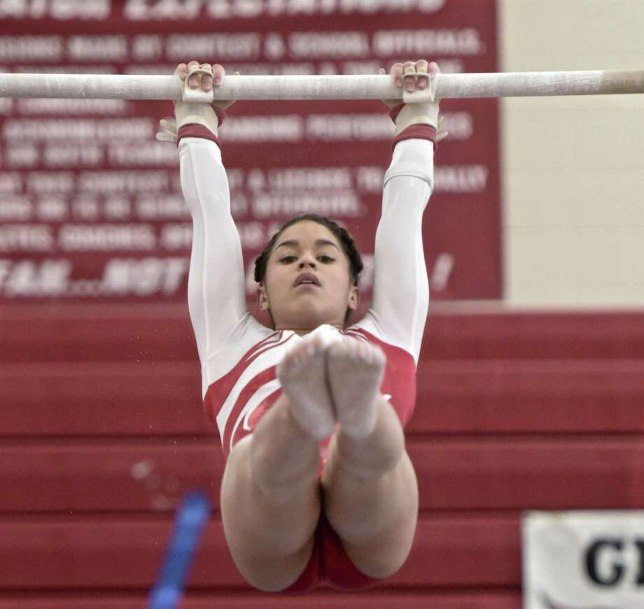 Adnerys De Jesus, Greenwich High School, competes in the uneven bars at the Connecticut State Open gymnastics meet, Saturday, March 3, 2018, at Pomperaug High School, in Southbury, Conn. Photo: H John Voorhees III / Hearst Connecticut Media / The News-Times