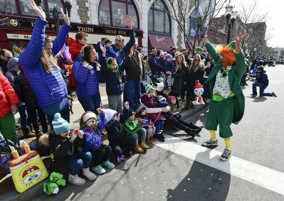 Charles Pia of Stamford, at right, livens up the Irish Spirit in the crowd during the City of Stamford's St. Patrick's Day Parade on Saturday, March 3, 2018 in Stamford, Connecticut. Photo: Matthew Brown / Hearst Connecticut Media / Stamford Advocate