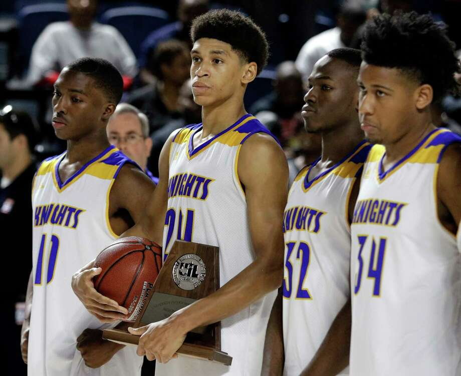 Elkins guard Elochukwu Nwodo (10), foward Vernon Harrell (24), foward Smon Omotola (32) and forward Kaleb Cheers (34) stand with the runners up trophy after losing to Port Arthur Memorial in the Region III 5A finals game at Delmar Field House Friday, Mar. 3, 2018 in Houston, TX. (Michael Wyke / For the  Chronicle) Photo: Michael Wyke, For The Chronicle / © 2018 Houston Chronicle