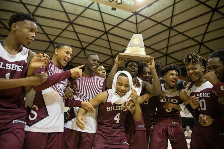 The Silsbee Tigers celebrate following their victory over the Jack Yates Lions in a 4A regional final game at Johnson Coliseum in Huntsville, Texas on Saturday, March 3, 2018. The Silsbee Tigers won 120-103. Photo: Loren Elliott, For The Houston Chronicle / © 2018 Houston Chronicle