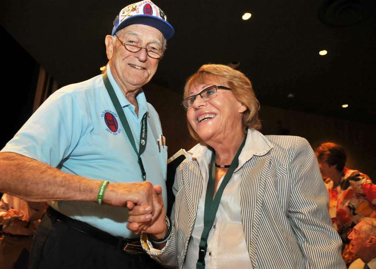 Army veteran Frank Towers, left, of Gainesville, Fla., found boxcars full of Nazi death camp victims in 1945, including Sara Atzmon of Israel, who was a 12-year-old rescued from the train. They meet Thursday at the Holocaust survivors reunion at Hudson Falls High School.