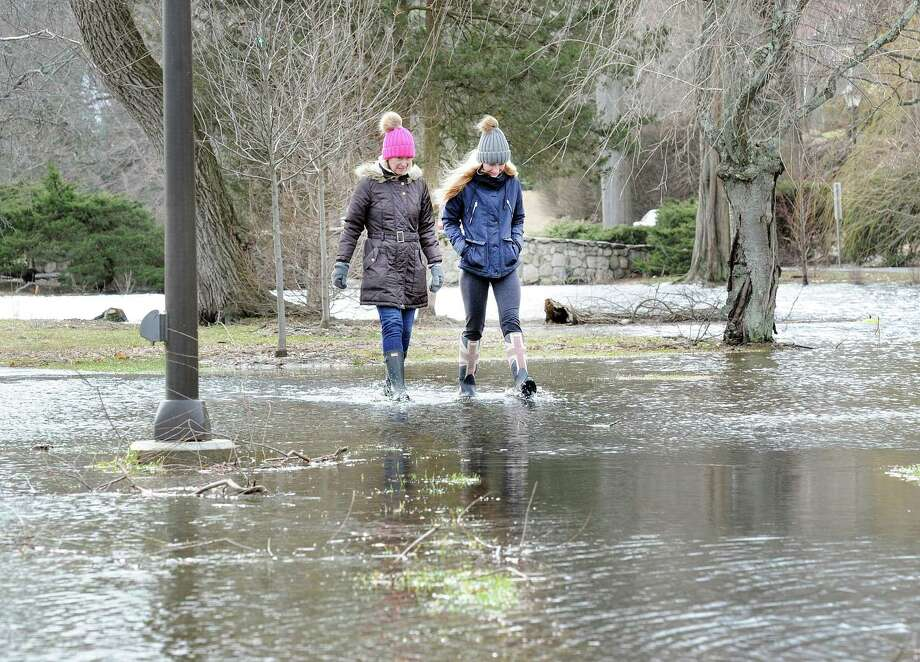 "When asked about storm damage from Friday's nor'easter Old Greenwich resident Keely Brook, left, replied, ""We were lucky"" as she walked with water-proof boots with her daughter Betsy Brook in a flooded Binney Park in Old Greenwich, Conn., Saturday, March 3, 2018. Brook said her home did not sustain damage from the storm and that everyone was safe. Photo: Bob Luckey Jr. / Hearst Connecticut Media / Greenwich Time"