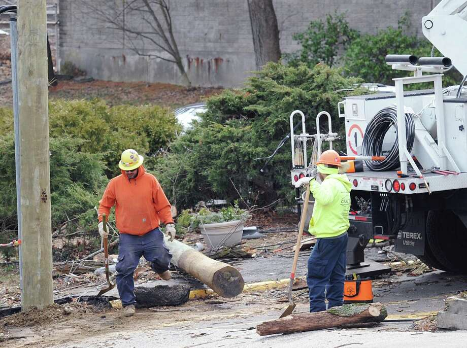 A utility crew works on Sound Beach Avenue during the aftermath of Friday's nor'easter in Old Greenwich, Conn., Saturday, March 3, 2018. Friday's storm, which left more than 1,000 Greenwich residents still without power into Monday evening, could be followed by a heavy winter storm this week. Photo: Bob Luckey Jr. / Hearst Connecticut Media / Greenwich Time
