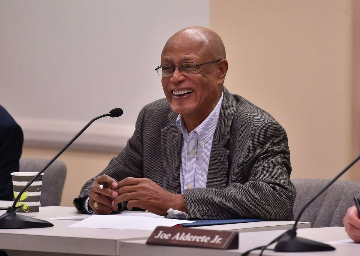 Alamo Colleges District trustee Denver McClendon speaks last year after a vote to confirm Palo Alto College President Mike Flores as the district's new chancellor. McClendon has announced he will step down halfway through his current term.