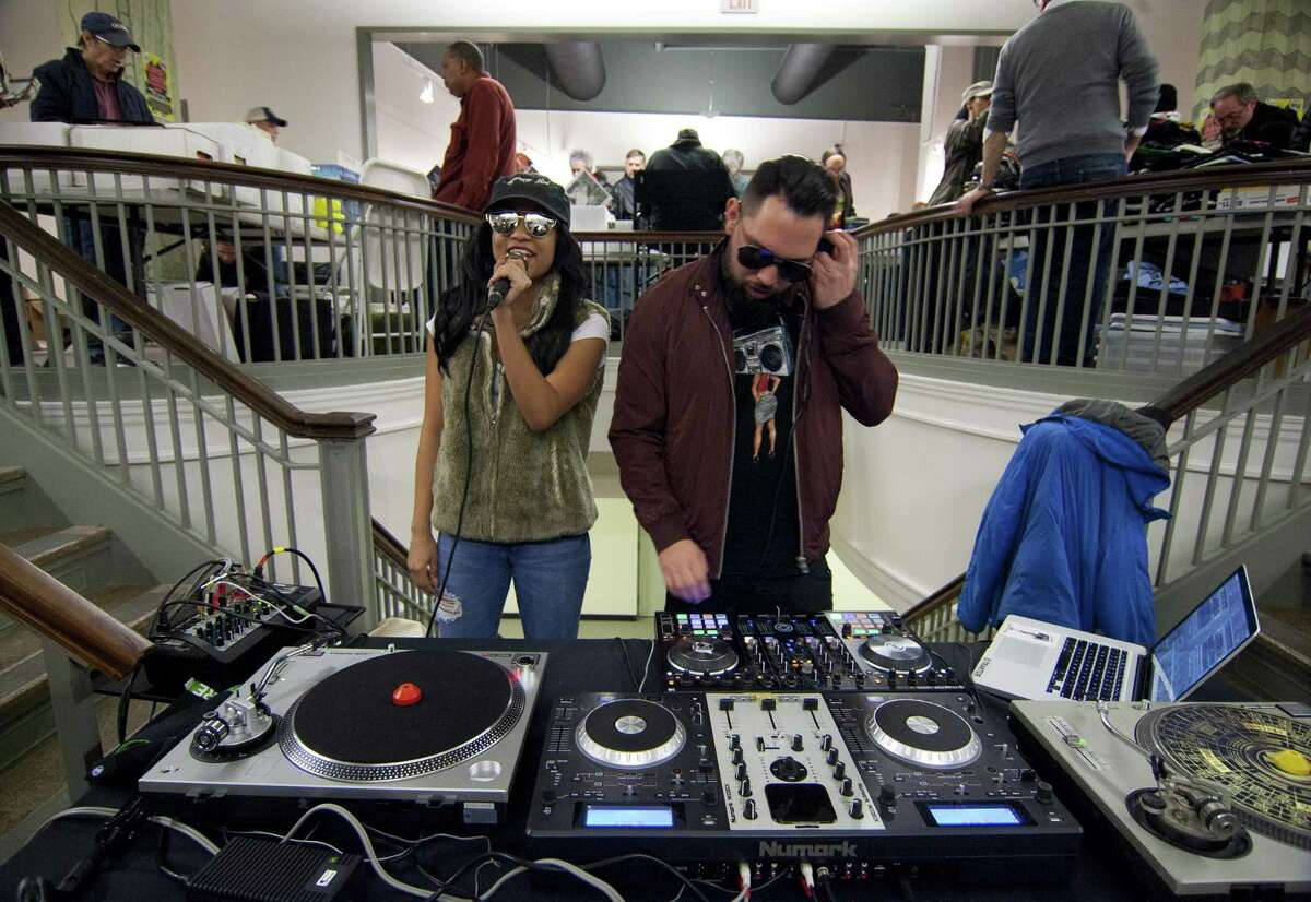 DJ Mystery Girl and DJ Enigma, right, entertain people attending WPKN's MUSIC MASH Record Fair 2018 at Read's Artspace building on Broad Street in Bridgeport, Conn., on Saturday, Mar. 3, 2018. MUSIC MASH 2018 featured 50+ vendors from all over New England selling vinyl LP's, 45's, CD's and music collectibles.