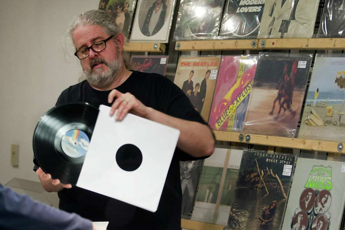 Vendor John Gorlewski, of Middletown, puts a record back in its sleeve during WPKN's MUSIC MASH Record Fair 2018 at Read's Artspace building on Broad Street in Bridgeport, Conn., on Saturday, Mar. 3, 2018. MUSIC MASH 2018 featured 50+ vendors from all over New England selling vinyl LP's, 45's, CD's and music collectibles.