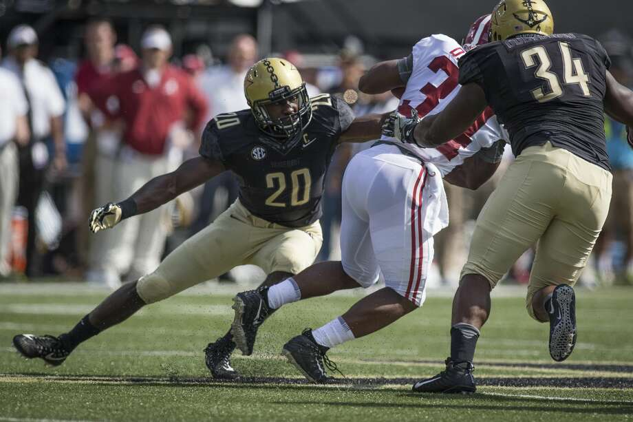 NASHVILLE, TN - SEPTEMBER 23: Vanderbilt (20) Oren Burks (LB) attempts a tackle during a college football game between the Vanderbilt Commodores and the Alabama Crimson Tide on September 23, 2017 at Commodore Stadium in Nashville, TN. (Photo by Jamie Gilliam/Icon Sportswire via Getty Images) Photo: Icon Sportswire/Icon Sportswire Via Getty Images