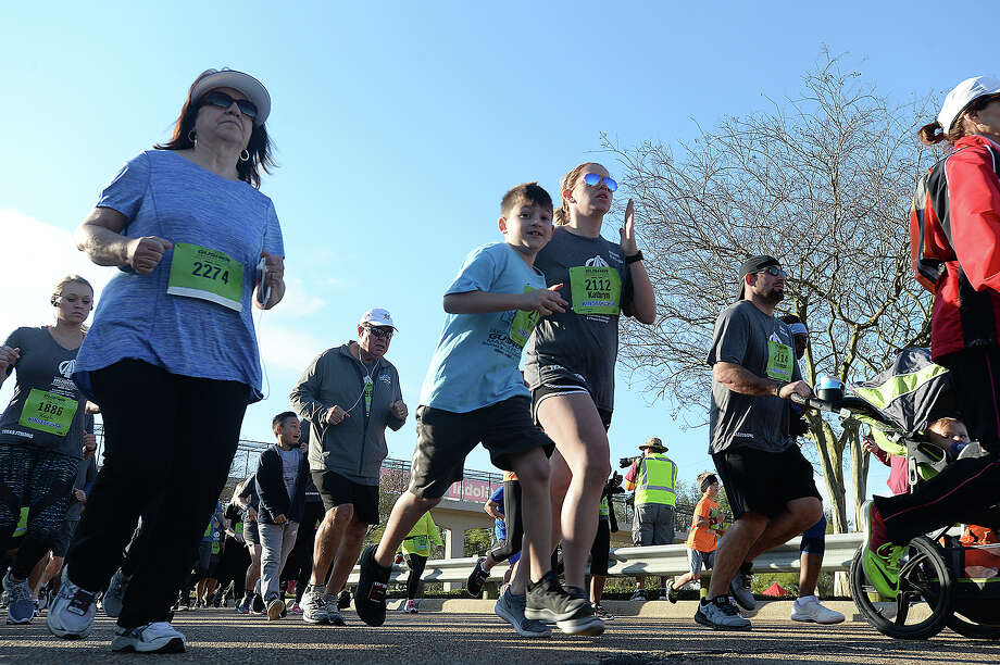 5K runners begin their race during the Gusher Marathon, Half Marathon and 5K through Beaumont Saturday. Photo taken Saturday, March 3, 2018 Kim Brent/The Enterprise Photo: Kim Brent / BEN