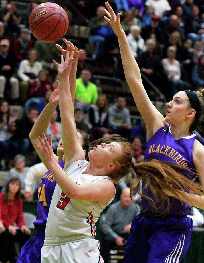 Tamarac's # 3 Kayla Doody, left, draws a foul from Voorheesville'defenders during their Class B girls' BB final game Saturday March 3, 2018 in Troy, NY.  (John Carl D'Annibale/Times Union) Photo: John Carl D'Annibale / 20043084A