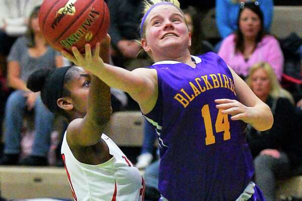Voorheesville's #14 Emily Burke, right, goes to the basket as Tamarac's # 20 Amani Henderson defends during their Class B girls' BB final game Saturday March 3, 2018 in Troy, NY.  (John Carl D'Annibale/Times Union)