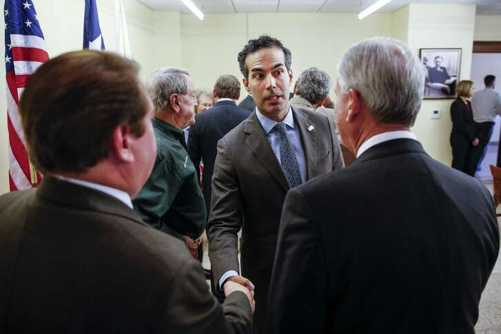Texas Land Commissioner George P. Bush, center, shakes hands with Rosenberg mayor William Benton, left, as he talks to Fort Bend Commissioner Precinct 1 Vincent Morales, right, after a roundtable discussion about the state of housing recovery after Hurricane Harvey at the Historic Courthouse Tuesday, Nov 28, 2017 in Richmond. ( Michael Ciaglo / Houston Chronicle)