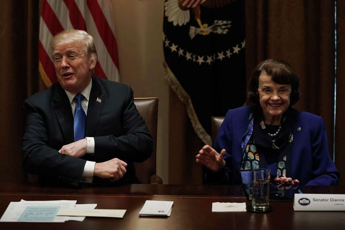 President Donald Trump and Sen. Dianne Feinstein, D-Calif., share a moment during a meeting with bipartisan members of the Congress to discuss school and community safety.