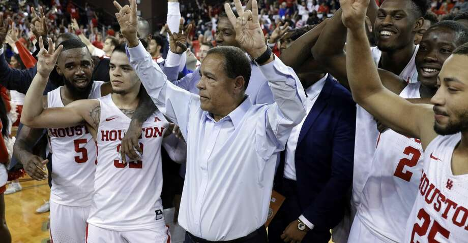 Houston head coach Kelvin Sampson and his players celebrate the 73-59 upset win over Wichita State after their game at H&PE Arena at Texas State University Saturday, Jan. 20, 2018, in Houston, TX. (Michael Wyke / For the  Chronicle) Photo: Michael Wyke/For The Chronicle