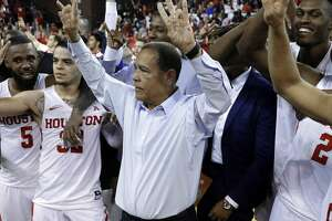 Houston head coach Kelvin Sampson and his players celebrate the 73-59 upset win over Wichita State after their game at H&PE Arena at Texas State University Saturday, Jan. 20, 2018, in Houston, TX. (Michael Wyke / For the  Chronicle)