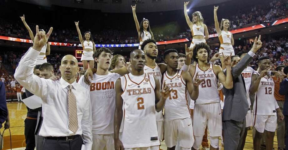 "Texas head coach Shaka Smart, left, sings the ""Eyes of Texas"" with his team after defeating West Virginia 87-79 in an NCAA college basketball game, Saturday, March 3, 2018, in Austin, Texas. (AP Photo/Michael Thomas) Photo: Michael Thomas/Associated Press"