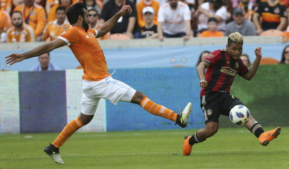 Houston Dynamo defender Kevin Garcia (16) tries to stop Atlanta United forward Josef Martinez (7) making a pass during the first half of the MLS game at BBVA Compass Stadium on Saturday, March 3, 2018, in Houston. ( Yi-Chin Lee / Houston Chronicle ) Photo: Yi-Chin Lee/Houston Chronicle