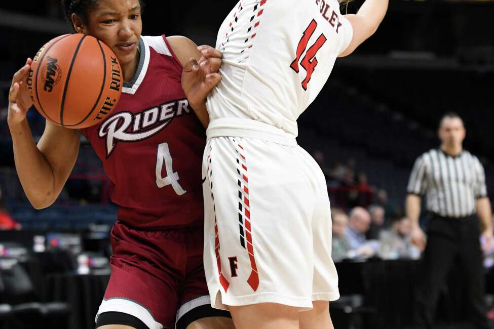 Rider University player Stella Johnson, left, is closely guarded by Casey Foley from Fairfield University, right, during MAAC championship basketball quarterfinals on Saturday, March 3, 2018, at the Times Union Center in Albany, N.Y. Rider won the game. (Will Waldron/Times Union)