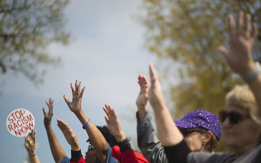 Women raise their hands protesting racism, bigotry and male chauvinism during Black Women's March rally, Saturday, March 3, 2018, in Houston. ( Marie D. De Jesus / Houston Chronicle )