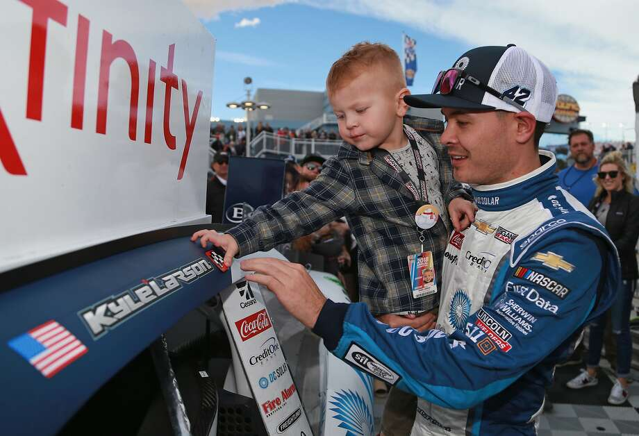Kyle Larson shares a moment with son Owen after winning the NASCAR Xfinity Series race at Las Vegas Motor Speedway. Photo: Matt Sullivan, Getty Images