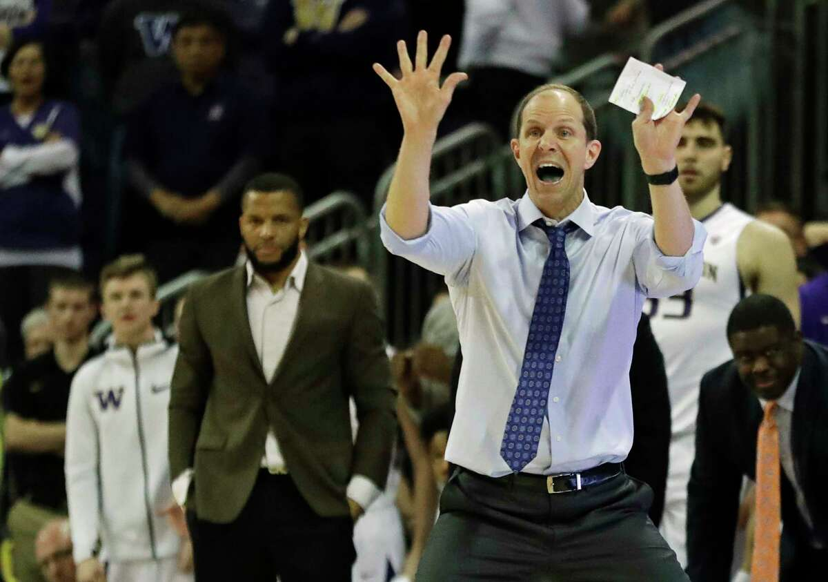 Washington head coach Mike Hopkins, right, calls to his team in the second half of an NCAA college basketball game against Oregon, Saturday, March 3, 2018, in Seattle. Oregon won 72-64.