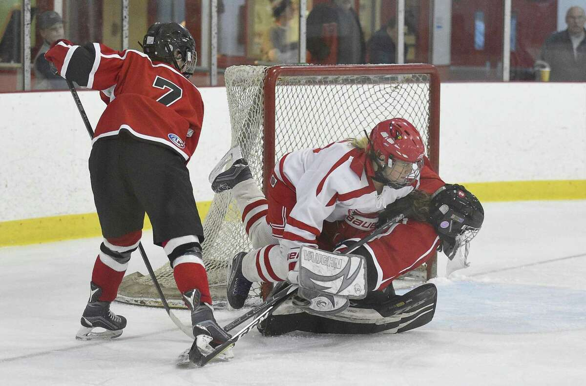 Greenwich's Jen Kelly crashes the backside of Branford goalie Julia SanGiovani during Saturday's contest.