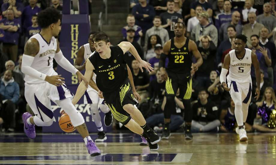Oregon guard Payton Pritchard drives against Washington on his way to 14 points in Seattle. Oregon won 72-64. Photo: Ted S. Warren, Associated Press