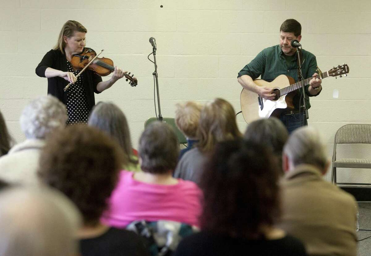 Traditional Irish fiddler Deirdre McMorrow and guitarist/vocalist Paul Pender, perform together during a free concert at the Seymour Public Library in Seymour, Conn., on Saturday, Mar. 3, 2018. Funding for this concert was provided through a grant from the Matthies Foundation.