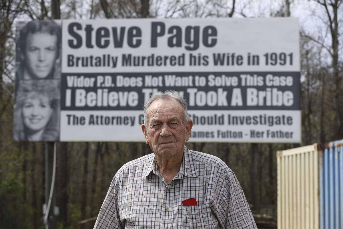 James Fulton poses for a photograph in front of one of his billboards by Interstate-10 westbound on Friday, March 2, 2018, in Rose City. The billboards accuse the Vidor Police Department of not working hard enough to solve the 1991 murder of Fulton's daughter, Kathy Page. Fulton started to put up billboards in the 1990s. Over the years, different billboards have been installed by Fulton, but his message remain the same. His billboards are believed to be the inspiration for the Oscar best-picture-nominated film