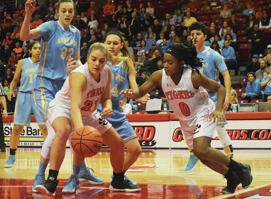 Edwardsville's Rachel Pranger (front left) and Quierra Love (front right) go after loose ball Saturday evening during the third-place game at the Class 4A girls basketball state tournament at Redbird Arena in Normal. Des Plaines Maine West defeated the Tigers 45-41, leaving Edwardsville with a 30-2 record and a fourth-place finish with its third state trophy to go along with runner-up trophies in 2017 and 2012. Maine West finished 32-2 in its first state finals appearance since placing second in 1993. Pranger and Love joined Myriah Noodel-Haywood with eight points for the Tigers, who were led by Kate Martin's 13 points. The eight points left Pranger with 1,805 career points, one-point short of Emmonnie Henderson's scoring record with the Tigers at 1,806. Photo: Matthew Kamp / For The Telegraph