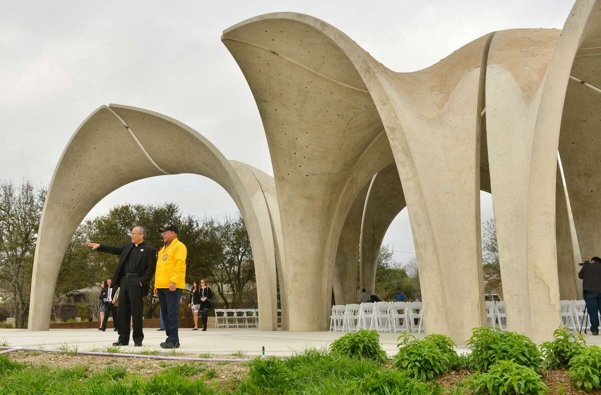 Father David Garcia and John Rodriguez look over Confluence Park during the grand opening Saturday. The 3.5-acre park, a project led by the San Antonio River Foundation, is south of downtown at 310 W. Mitchell St., where San Pedro Creek connects to the river just northwest of Mission Concepción. In planning stages since 2012 and under construction since May 2016, it is a $13 million project supported with public and private funds.