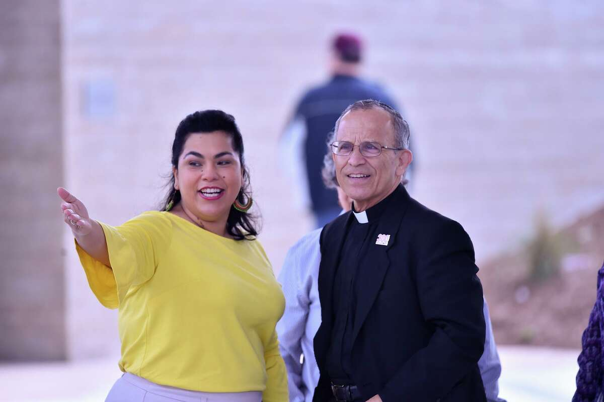 Councilwoman Rebecca Viagran points out portions of Confluence Park to Father David Garcia during the park's grand opening last year. Garcia, who last month retired from pastoral work, has been lauded for his dedication to the San Antonio community.