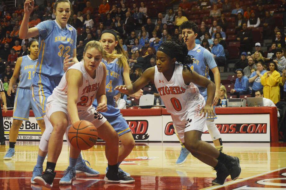 EHS players Quierra Love, right, and Rachel Pranger battle for a rebound.