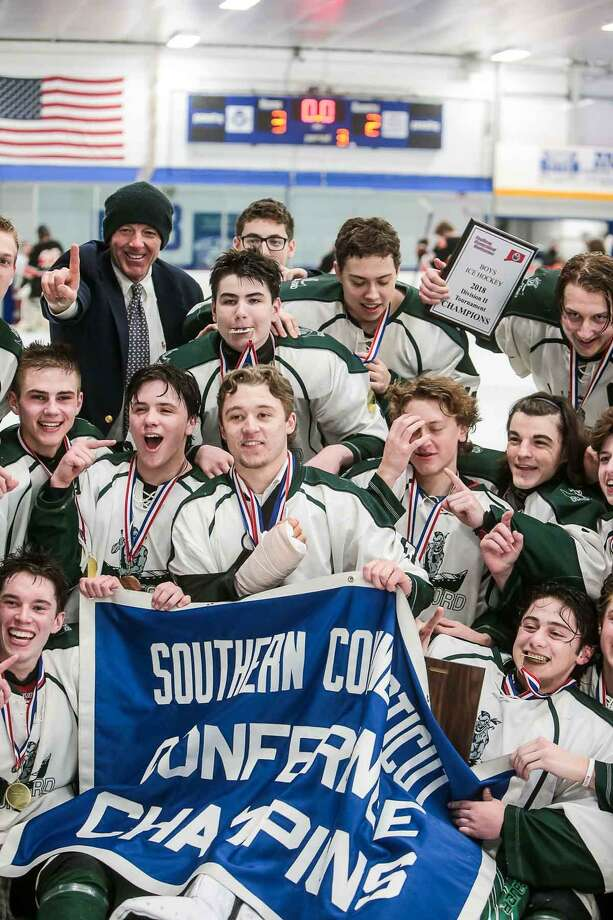 Members of the Guilford hockey team celebrate their win in the SCC-SWC Division II championship game on Saturday at Bennett Rink in West Haven. Photo: John Vanacore / For Hearst Connecticut Media / (c)John H.Vanacore