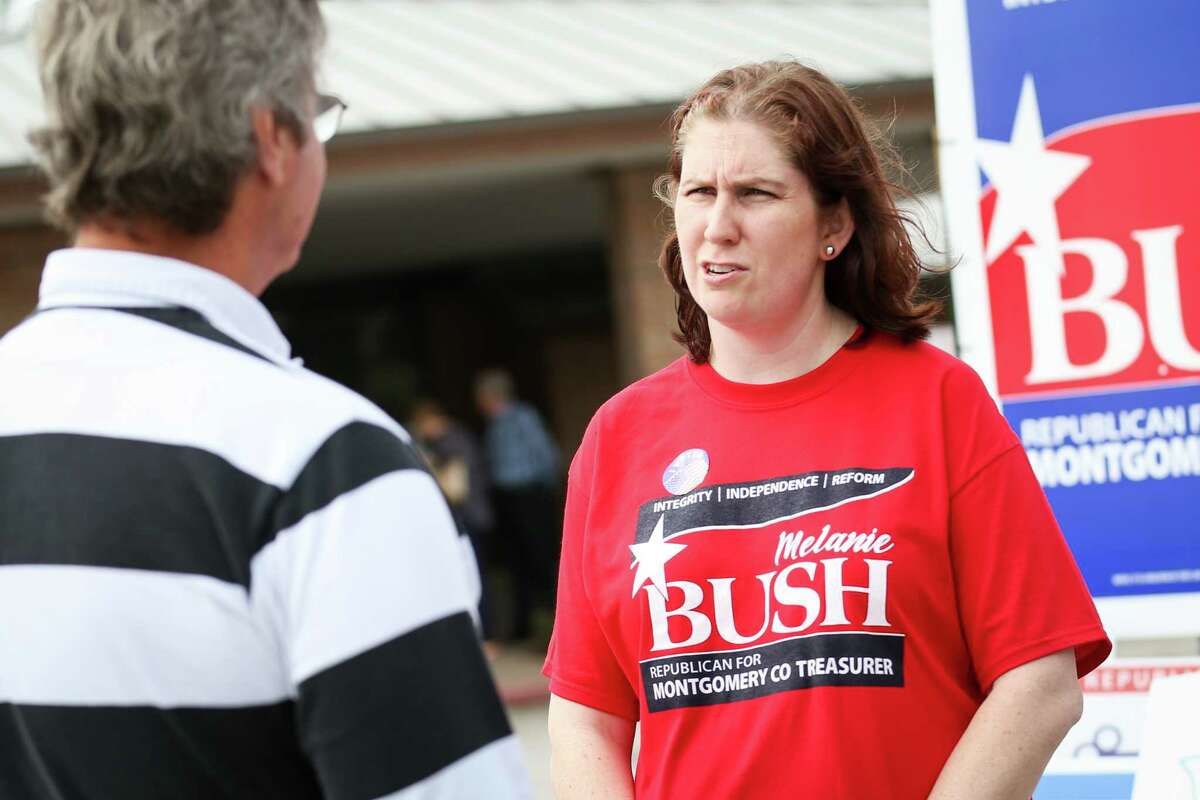Montgomery County Treasurer candidate Melanie Bush speaks with voters outside of the South County Community Center polling location during the first day of early voting on Tuesday, Feb. 20, 2018.