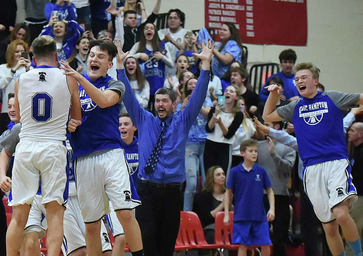 East Hampton celebrates following their 58 - 54 win over Cromwell, Saturday, March 3, 2018, in the Shoreline championship game at the Salisbury Gymnasium at Wilbur Cross High School in New Haven.