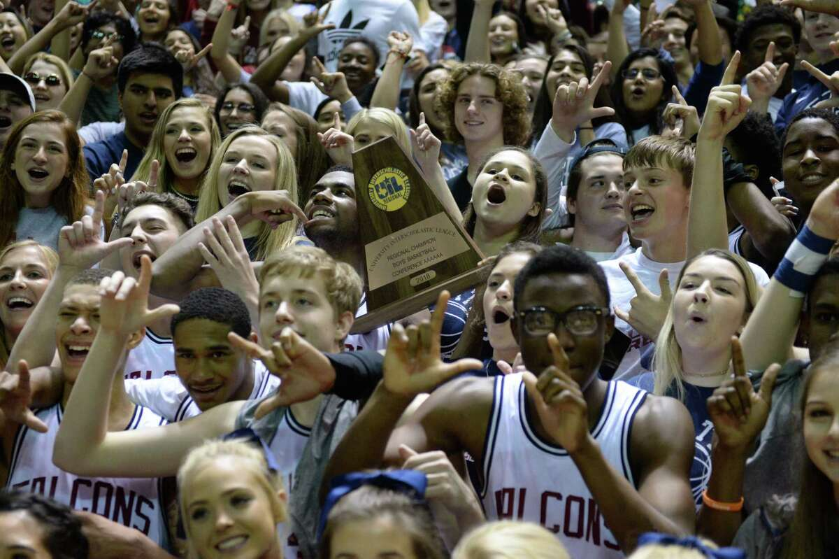 The Tompkins Falcons celebrate with their fans after beating the Alief Taylor Lions 60-43 to win the Region III Class 6A championship Saturday at the Berry Center. The Falcons move on to the Class 6A final four.