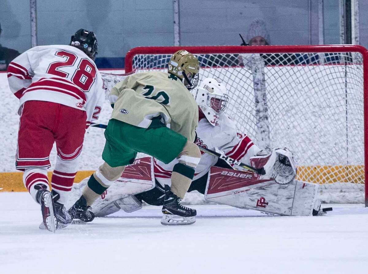 Fairfield Prep goaltender John McGee makes a breakaway save on Notre Dame's Christopher Hibson Saturday in West Haven.