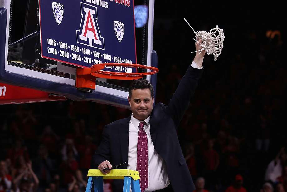 Arizona head coach Sean Miller cuts down the nets to win the Pac-12 Championship after defeating the Cal Golden Bears. Photo: Christian Petersen, Getty Images