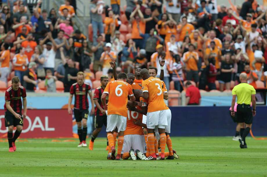 Dynamo players gather to celebrate Philippe Senderos' goal in the 23nd minute of the team's MLS season opener at BBVA Compass Stadium against Atlanta United FC. It was his first MLS goal. Photo: Yi-Chin Lee, Staff / © 2018 Houston Chronicle